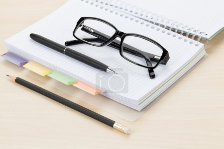 Office table with  notepad and pencil