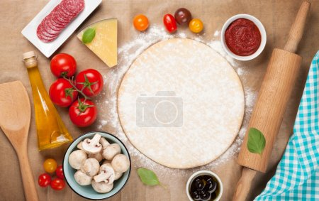 Photo for Pizza cooking ingredients. Top view with copy space - Royalty Free Image