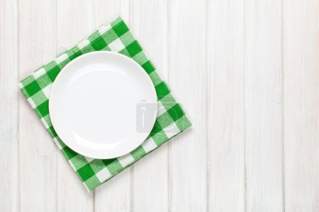 Photo for Empty plate and towel over wooden table background. View from above with copy space - Royalty Free Image