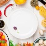 Italian food cooking ingredients. Pasta, vegetable...