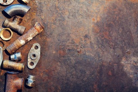 Photo for Workbench metal table with old water supply parts. Top view with copy space - Royalty Free Image