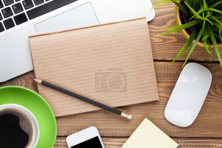 Photo for Office desk table with computer, supplies, coffee cup and flower. Top view with copy space - Royalty Free Image