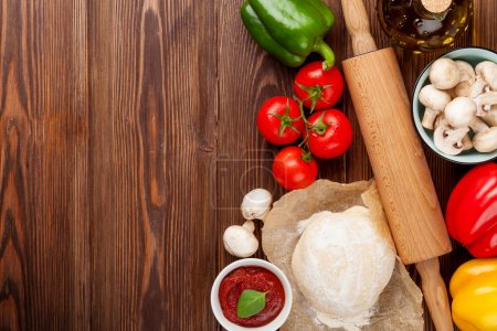Photo for Pizza cooking ingredients Dough, vegetables and spices - Royalty Free Image