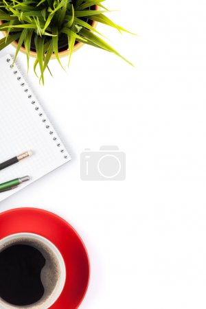 Office table with supplies and coffee cup