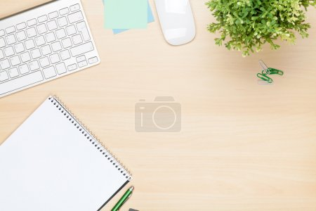 Office table with notepad, computer