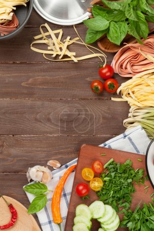 Photo for Pasta cooking ingredients and utensils on wooden table. Top view with copy space - Royalty Free Image