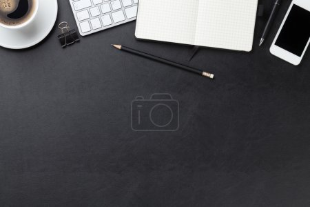 Photo for Office leather desk table with computer, supplies and coffee cup. Top view with copy space - Royalty Free Image