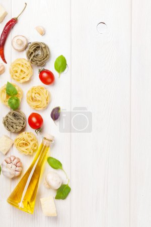 Photo for Italian food cooking ingredients. Pasta, tomatoes, basil. Top view with copy space - Royalty Free Image