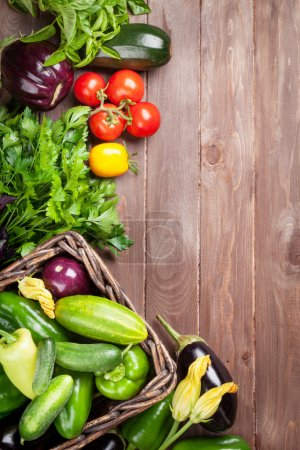 Photo for Fresh farmers garden vegetables on wooden table. Top view with copy space - Royalty Free Image