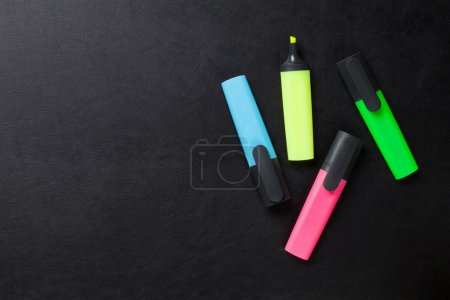 Colorful highlighters on desk