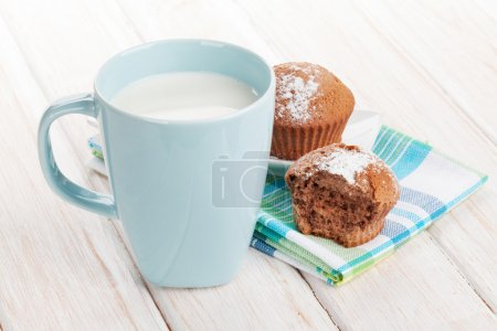 Cup of milk and cakes