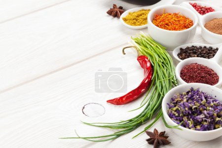Photo for Various spices on white wooden background. Top view with copy space - Royalty Free Image