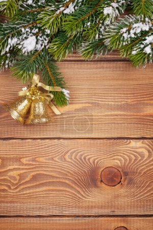 Photo for Christmas fir tree with snow and holiday decor on rustic wooden board with copy space - Royalty Free Image