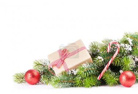 Christmas tree branch with gift box