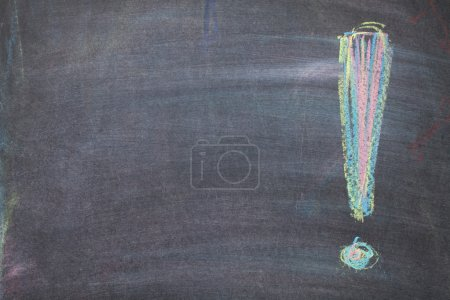 Colorful chalk exclamation mark on blackboard