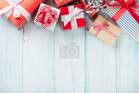 Christmas gift boxes on wooden table