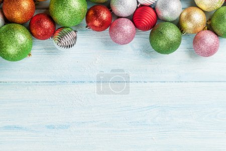 Christmas wooden background with baubles