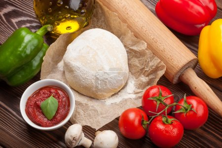 Photo for Pizza cooking ingredients. Dough, vegetables and spices - Royalty Free Image