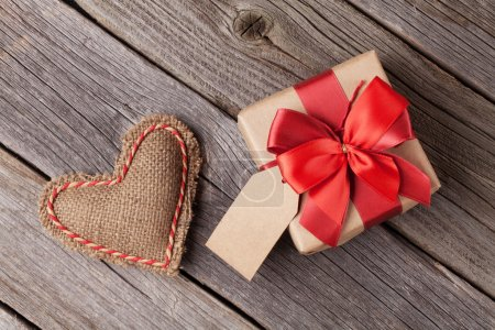 Photo for Valentines day toy heart and gift box on wooden table - Royalty Free Image