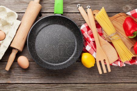 Photo for Cooking utensils and ingredients on wooden table. Top view with copy space - Royalty Free Image