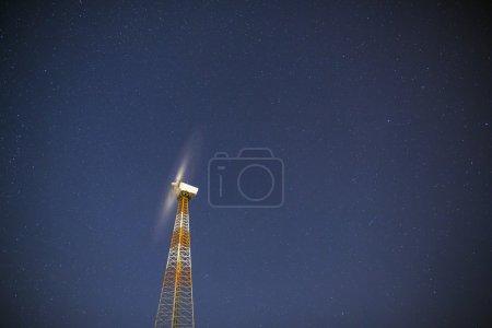 Windmill turbine on night sky