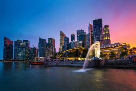 Photo for Singapore skyline, Marina bay and Merlion fountain view at dusk - Royalty Free Image