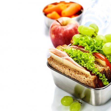 Photo for Lunch box with sandwich, fruits and water on white background - Royalty Free Image
