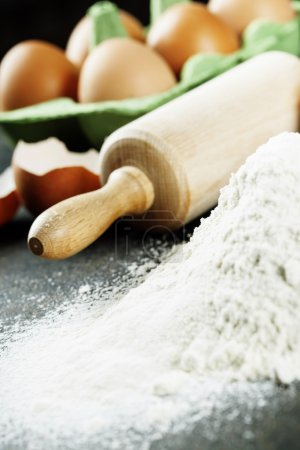 Photo for Baking background with raw eggs, rolling pin and flour - Royalty Free Image