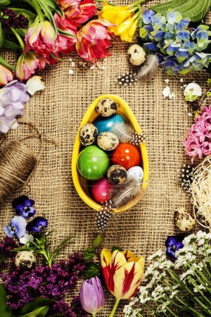 Photo for Easter background with eggs, nest and flowers - Royalty Free Image