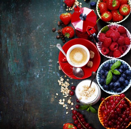 Photo for Healthy breakfast - yogurt with muesli and berries - health and diet concept. Blue background - Royalty Free Image