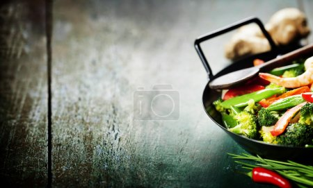 Photo for Chinese cuisine. Colorful stir fry in a wok. Shrimps with vegetables - Royalty Free Image