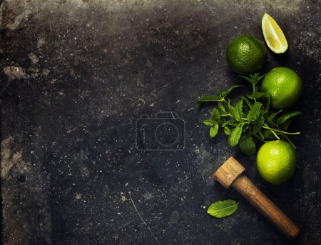 Photo for Ingredients for making mojitos (ice cubes, mint leaves, sugar and lime on rustic background) - Royalty Free Image