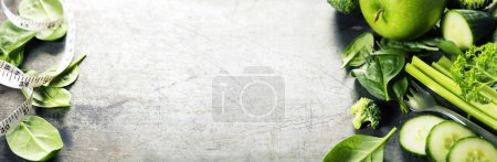 Photo for Fresh green vegetables on vintage background - detox, diet or healthy food concept - Royalty Free Image