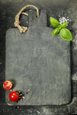 Photo for Vintage cutting board and fresh ingredients - Cooking, Healthy Eating or Vegetarian concept - Royalty Free Image