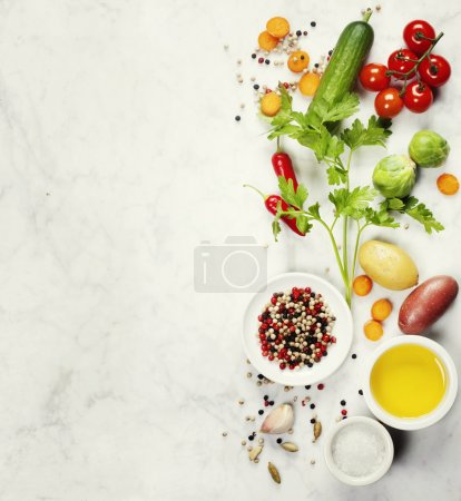 Photo for Various colorful spices and vegetables on marble table. Bio Healthy food, herbs and spices. Organic vegetables. Vegetarian food. Background layout with free text space. - Royalty Free Image