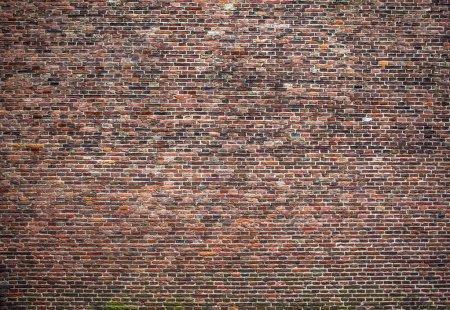 Antique brick stone wall texture. Photo Background.