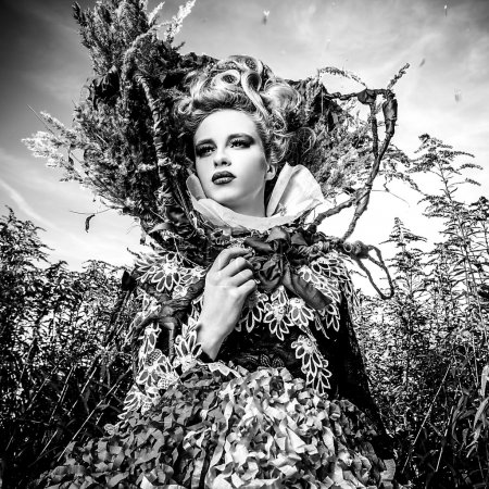 Dramatized image of sensual girl symbolizing nature. Black-white art fashion outdoor photo.