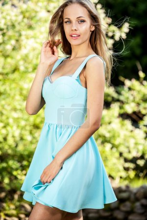 Outdoors portrait of beautiful young blonde woman