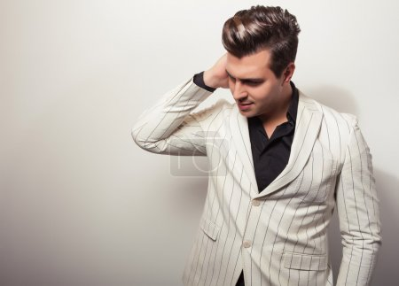 Photo for Elegant young handsome man in white costume. Studio fashion portrait. - Royalty Free Image