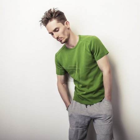Photo for Portrait of young handsome man in green t-shirt. - Royalty Free Image