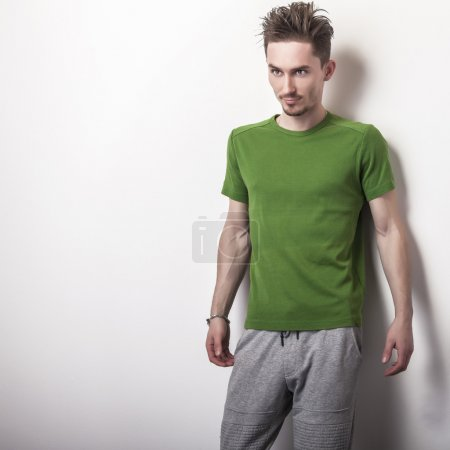 Young handsome man in green t-shirt.