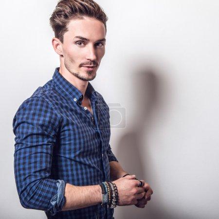 man in stylish dark blue shirt