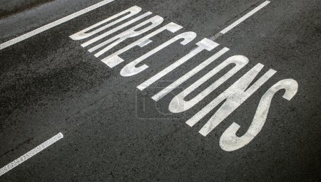 """Photo for Road sign """"Direction"""" on asphalt ground - Royalty Free Image"""