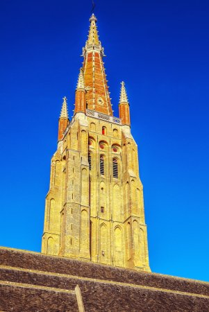 Medieval Church of Our Lady in Bruges in sunny evening, Belgium.