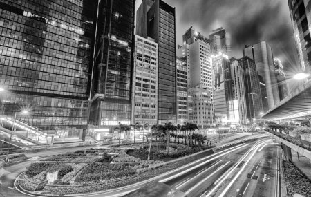 Photo for HONG KONG - APRIL 3, 2014: Black and white modern skyline at night. Hong Kong attract 30 million tourists every year. - Royalty Free Image