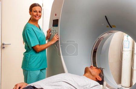 Happy male patient undergoing CT scan