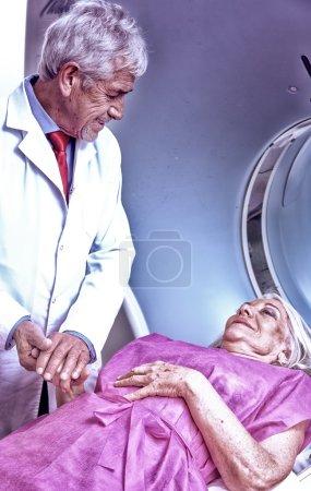 Patient undergoing scan test in hospital room