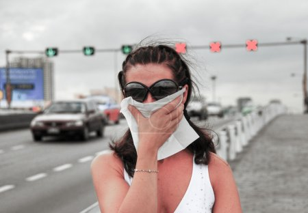 Woman fighting smog along city streets