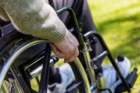Photo pour Fauteuil roulant en plein air. Concept de soins de santé. - image libre de droit