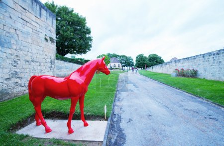 Red horse statue inside Chateau Ducal